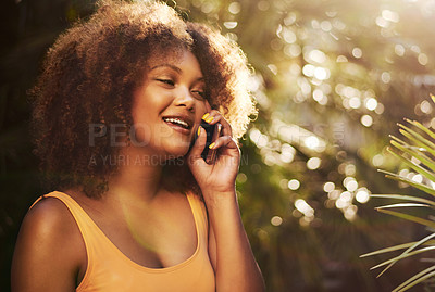 Buy stock photo Cropped shot of a beautiful young woman on a call in nature