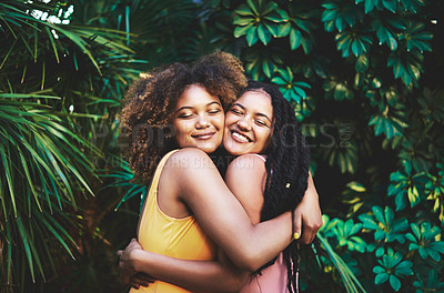 Buy stock photo Cropped shot of two beautiful young women embracing each other in nature