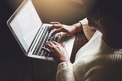 Buy stock photo Closeup shot of an unrecognizable woman using a laptop at home