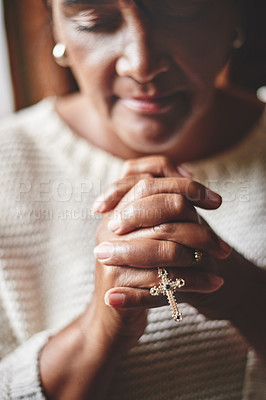 Buy stock photo Shot of a mature woman holding a rosary while praying