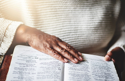 Buy stock photo Closeup shot of an unrecognizable woman reading the Bible at home