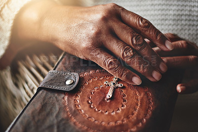Buy stock photo Closeup shot of an unrecognizable woman holding a rosary and Bible