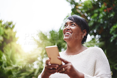 Buy stock photo Shot of a mature woman using a cellphone outdoors