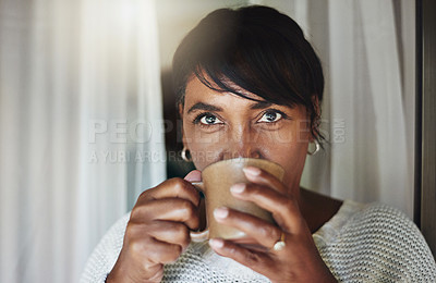 Buy stock photo Portrait of a mature woman relaxing with a cup of coffee at home