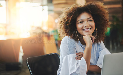 Buy stock photo Cropped portrait of an attractive young female designer working on her laptop in the office