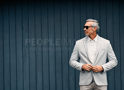 Buy stock photo Cropped shot of a smartly dressed mature businessman standing outside