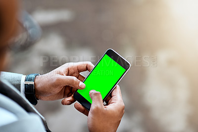 Buy stock photo Closeup shot of an unrecognizable businessman using a cellphone with a screen green in an office
