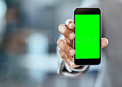 Buy stock photo Closeup shot of an unrecognizable businessman holding up a cellphone with a green screen in an office