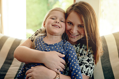 Buy stock photo Shot of a mother and her little girl spending time together at home