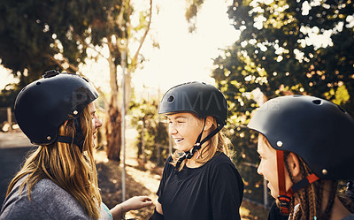 Buy stock photo Shot of a group of young girls skateboarding together at a skatepark