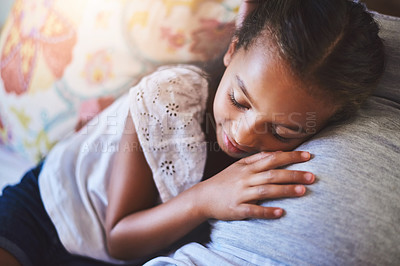 Buy stock photo Shot of an adorable little girl resting on her mother's pregnant stomach at home