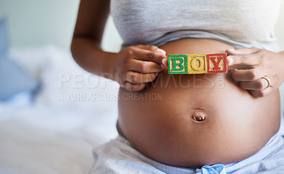 Buy stock photo Cropped shot of a pregnant woman with wooden blocks on her belly that spell the word boy