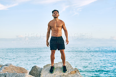 Buy stock photo Portrait of a shirtless and muscular young man standing outdoors
