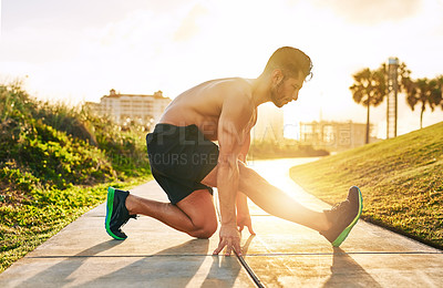 Buy stock photo Shot of a handsome young man exercising outdoors