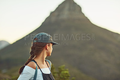 Buy stock photo Cropped shot of an unrecognizable woman looking back in nature