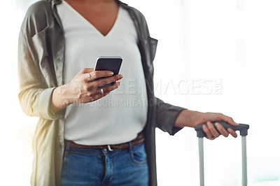 Buy stock photo Cropped shot of an unrecognizable woman using a cellphone in an airport