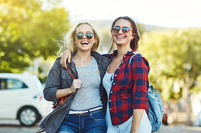Buy stock photo Cropped shot of two beautiful female friends sight seeing in the city