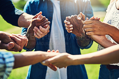 Buy stock photo Closeup shot of an unrecognizable group of people holding hands outdoors