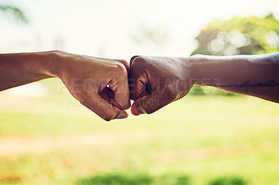 Buy stock photo Closeup shot of two unrecognizable people fist bumping outdoors