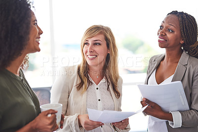 Buy stock photo Cropped shot of a group of businesswomen working in the office