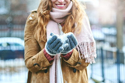 Buy stock photo Shot of an unrecognizable woman enjoying being out in the snow