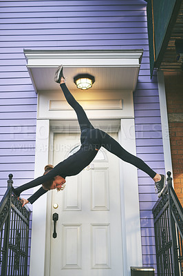 Buy stock photo Full length shot of an attractive young female athlete exercising on her front porch