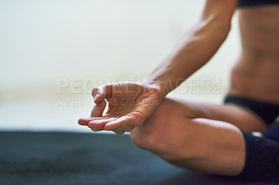 Buy stock photo Cropped shot of an unrecognizable young female athlete meditating at home