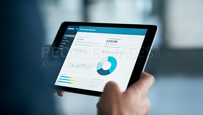 Buy stock photo Closeup shot of a businessman analyzing statistics on a digital tablet in an office