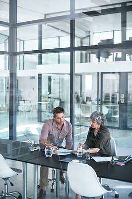 Buy stock photo Shot of a businessman and businesswoman having a meeting in a modern office