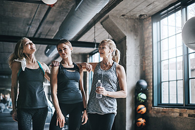 Buy stock photo Cropped portrait of three attractive and athletic women working out in the gym