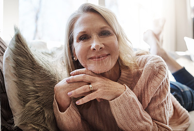 Buy stock photo Shot of an attractive mature woman relaxing at home