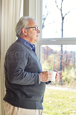 Buy stock photo Cropped shot of a senior man relaxing at home