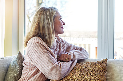 Buy stock photo Cropped shot of an attractive mature woman relaxing at home