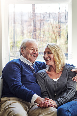 Buy stock photo Cropped shot of an affectionate senior married couple spending time together at home