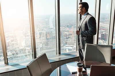 Buy stock photo Shot of a young businessman working in a modern office