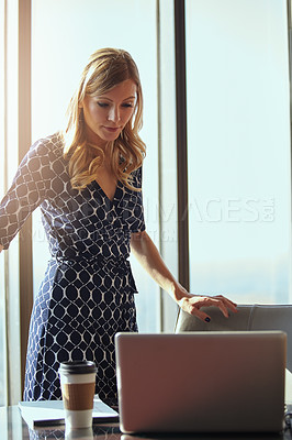 Buy stock photo Cropped shot of an attractive young businesswoman working in a modern office