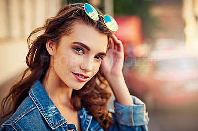 Buy stock photo Portrait of a beautiful young woman in the city