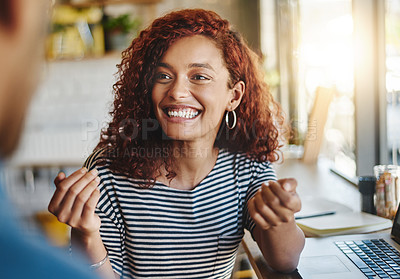 Buy stock photo Shot of two people having a discussion in a cafe