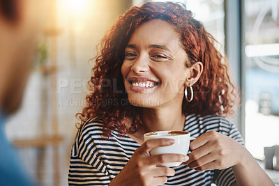 Buy stock photo Shot of a young woman having coffee with her boyfriend in a cafe
