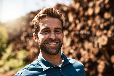 Buy stock photo Cropped portrait of a lumberjack standing in front of a pile of wood