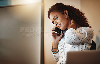 Buy stock photo Shot of a young businesswoman experiencing tension during a late night at work