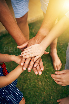 Buy stock photo Cropped shot of an unrecognizable father and his children joining hands in unity outside