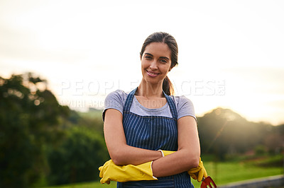 Buy stock photo Cropped portrait of an attractive young woman standing with her arms folded on her farm