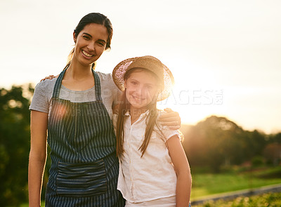 Buy stock photo Cropped portrait of an attractive young woman and her daughter standing on their family farm