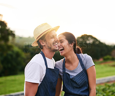 Buy stock photo Cropped shot of an affectionate young couple laughing while working on their privately owned farm