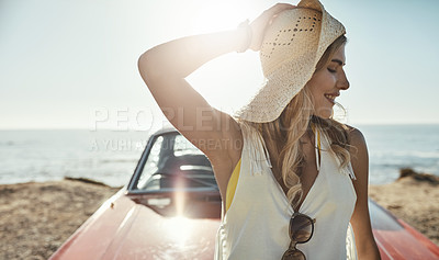 Buy stock photo Cropped shot of an attractive young woman on a road trip