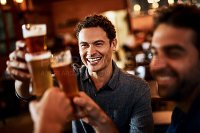 Buy stock photo Shot of a group of young friends seated at a table together while enjoying a beer and celebrating with a celebratory toast inside a bar