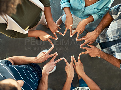 Buy stock photo High angle shot of an unrecognizable group of work colleagues forming an unique huddle with their fingers while standing in the office at work