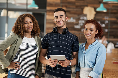 Buy stock photo Portrait of a group of young designers working together in an office