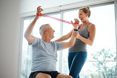 Buy stock photo Cropped shot of an attractive mature woman helping her husband with his workout at home